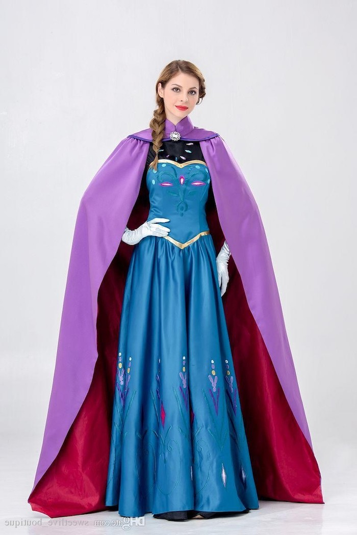 woman dressed as anna, frozen inspired costume, blue dress, purple cape, halloween costume ideas for women