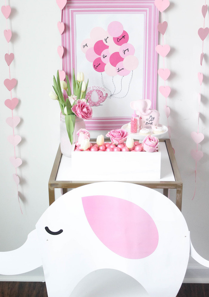 fun game, name guessing, pink frame, baby shower ideas, pink hearts garland, small tulips bouquet