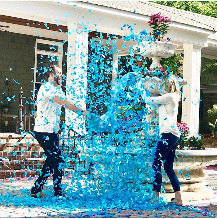man and woman, fighting with pillows, gender reveal ideas, blue confetti in the air