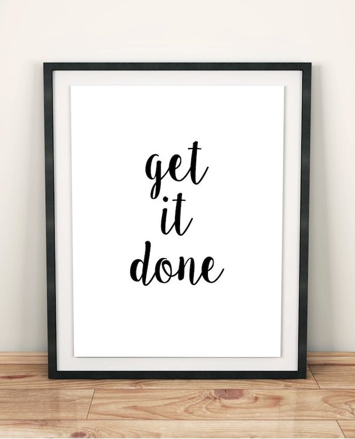 get it done, framed inspirational quote, on wooden desk, desk decor ideas, white wall