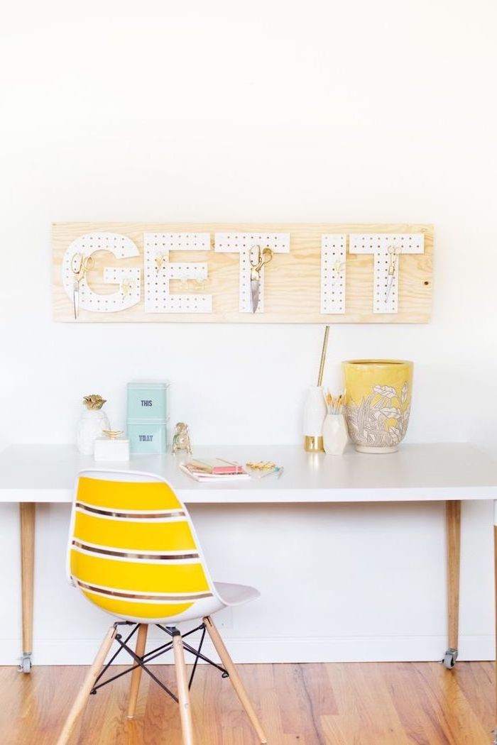 get it, peg board, wooden floor, white desk, yellow chair, office cubicle decor, tin cans, white wall