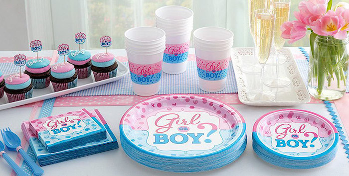 paper plates and cups, gender reveal gifts, small cupcakes, pink and blue frosting