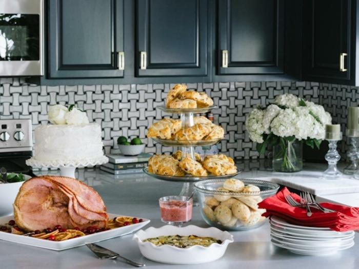 brunch table, large ham, baked casserole, white cake, plates and forks, best brunch recipes