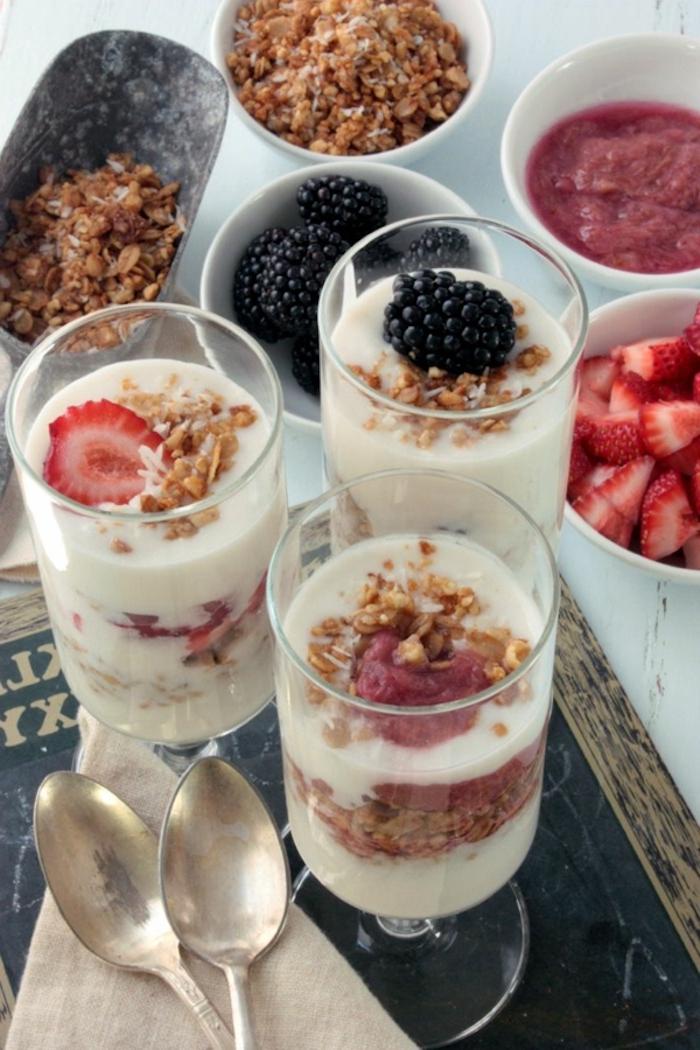 granola and yoghurt, in a glass, breakfast menu ideas, different garnish, in white bowls