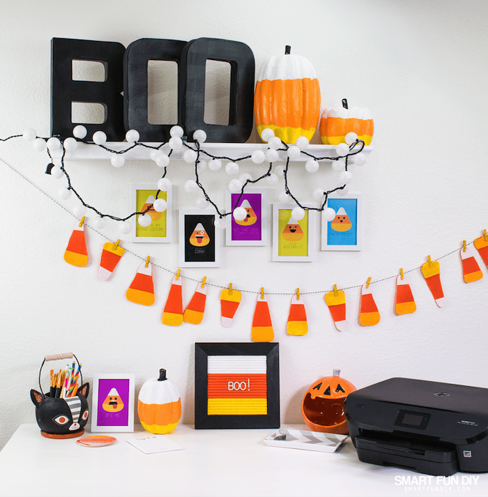 cute office decor, halloween decorations, ceramic pumpkins, black printer, pumpkin lanterns, fairy lights