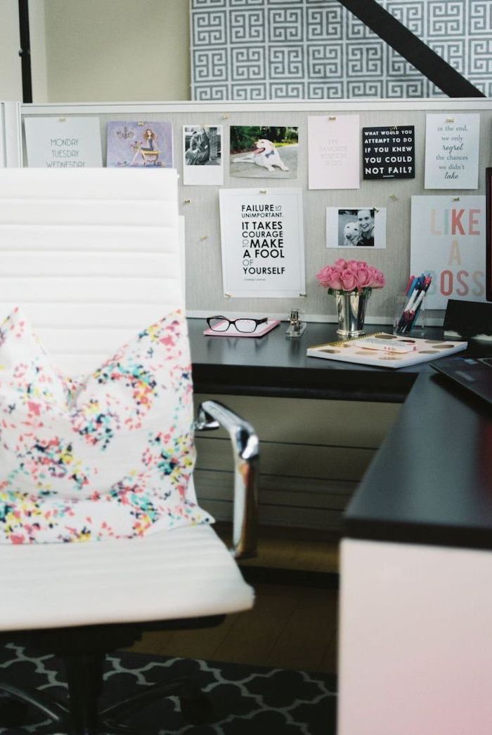 office decor ideas for work, hanging inspirational quotes, white leather chair, colorful throw pillow