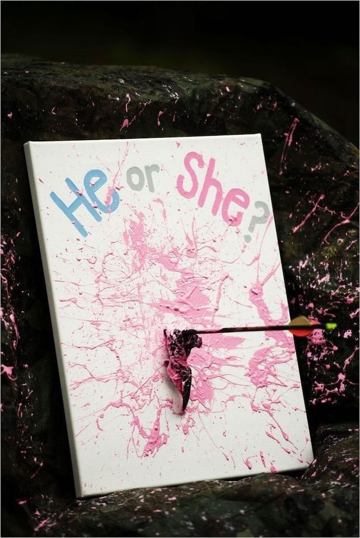 he or she, white background, gender reveal gifts, arrow piercing a black balloon, pink paint