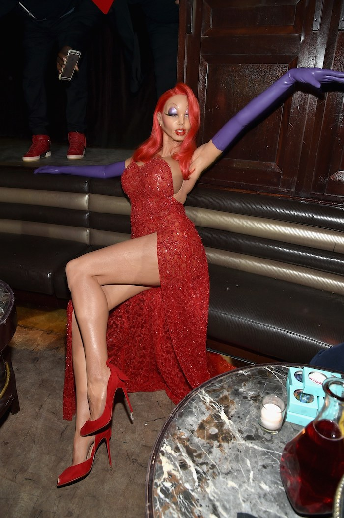 easy halloween costumes, heidi klum, dressed as jessica rabbit, red dress, red wig, purple leather gloves