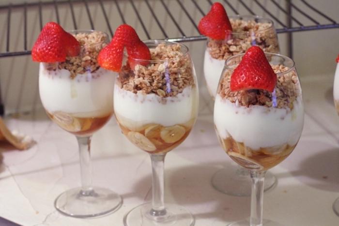 bananas and honey, yoghurt and granola, in wine glasses, breakfast potluck, chopped strawberries