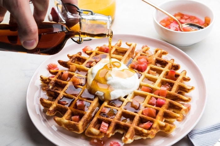large waffle, with jam, cream and honey, breakfast potluck, white plate, small white bowl with jam