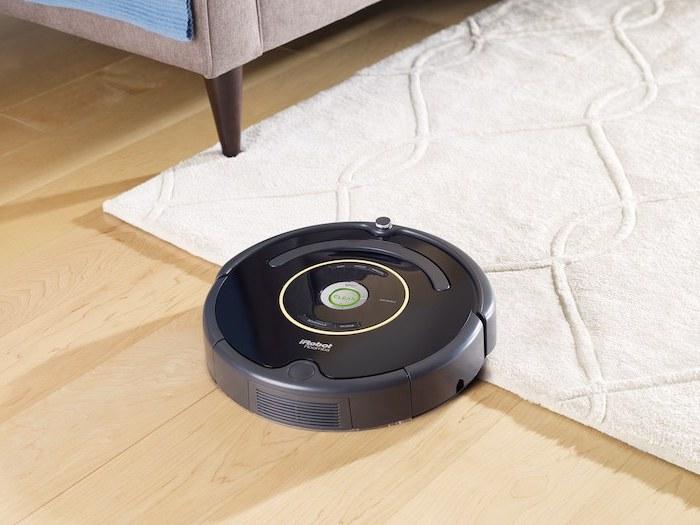 roomba irobot, best vacuum cleaner, wooden floor, white carpet, gray sofa