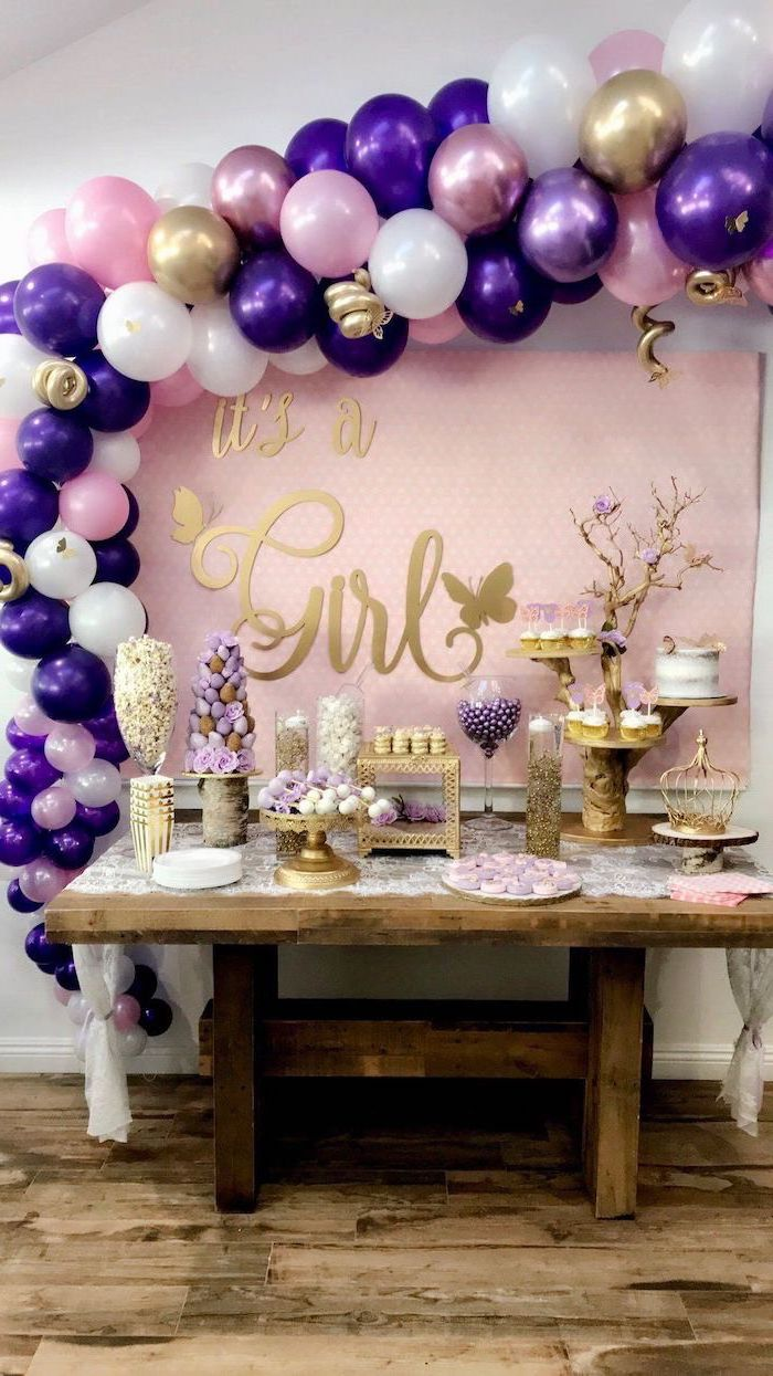 it's a girl, wooden table, dessert table, rustic decor, purple pink and white balloons, baby shower centerpieces girl