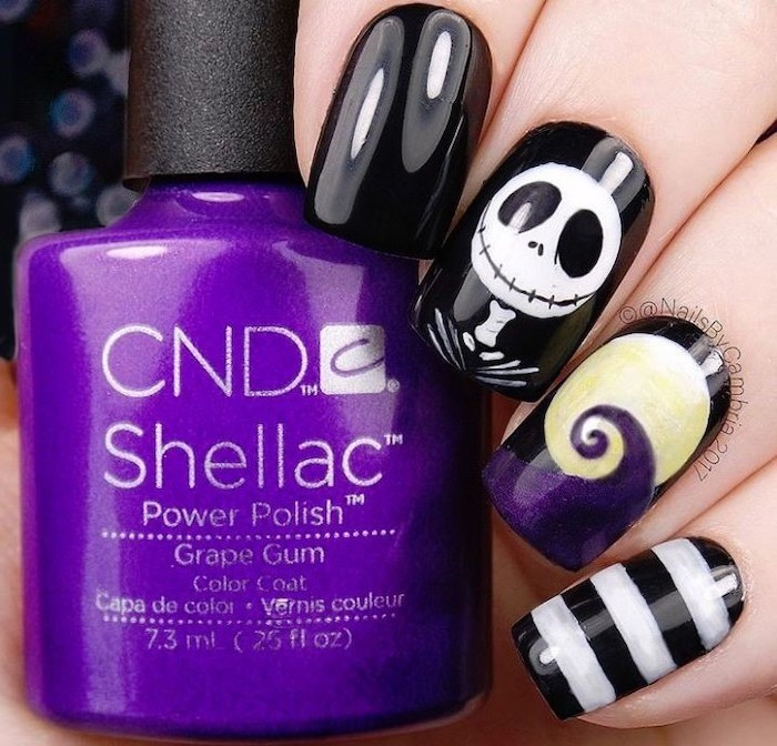 black nail polish, purple nail polish bottle, jack skellington, nightmare before christmas, black and gold nail designs