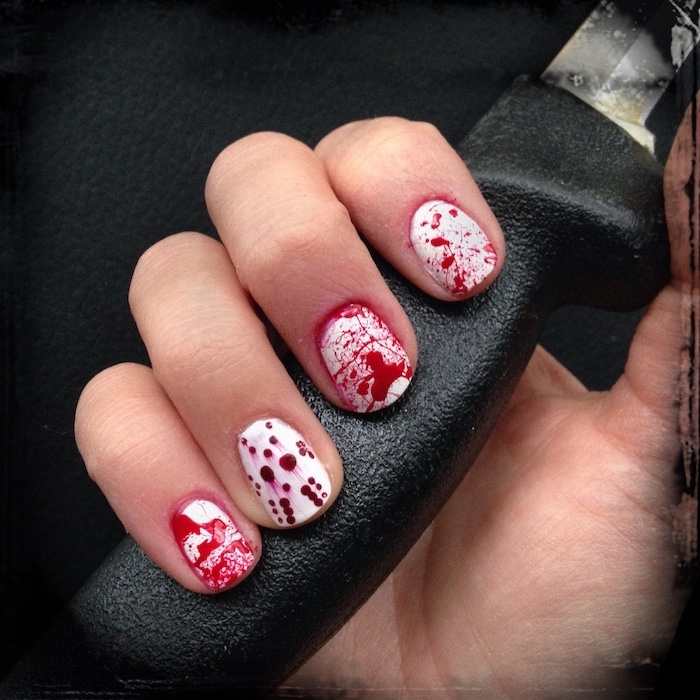 bloody nails, black and gold nail designs, jason voorhees, hand holding a knife, black background, short nails