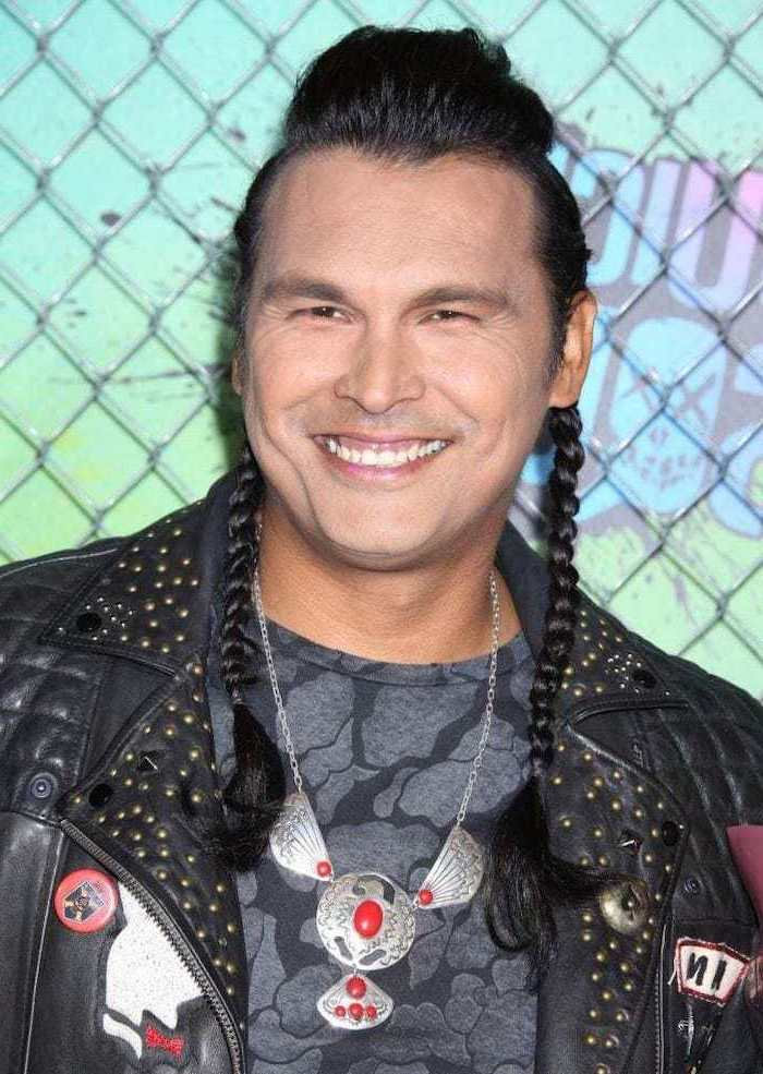 adam beach, two long side braids, black hair, braided hair men, black leather jacket, grey t shirt, silver necklace