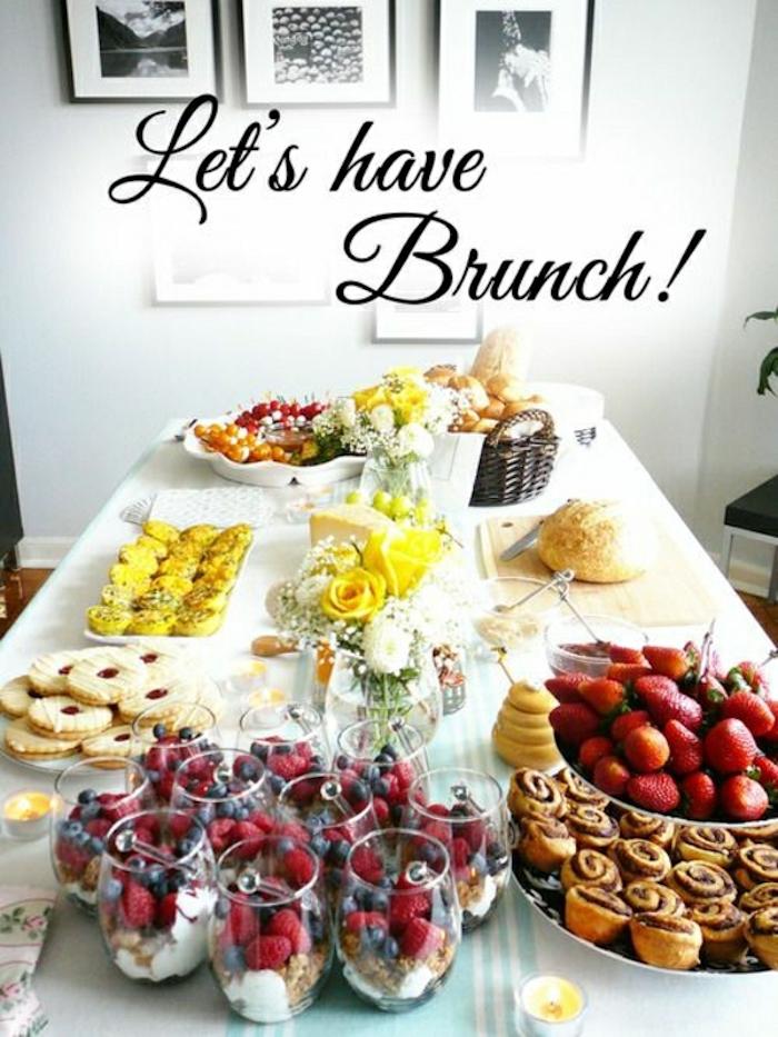 let's have brunch, brunch items, brunch table, granola and yoghurt, different fruits, cinnamon buns