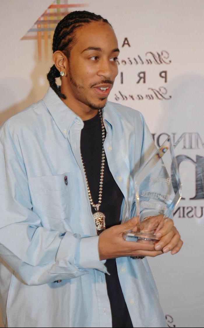 braids hairstyles 2019, ludacris holding an award, wearing a blue shirt, black t shirt, silver necklace