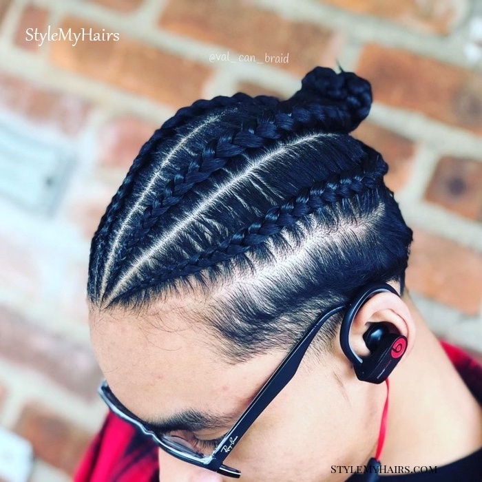 man with black hair, ray ban glasses, beats by dre headphones, brick wall, braided hair men