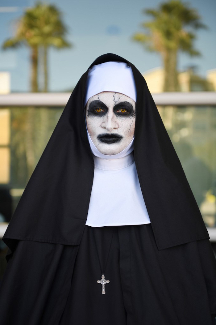 woman dressed as the nun, from the conjuring, scary face make up, what should i be for halloween, contact lenses