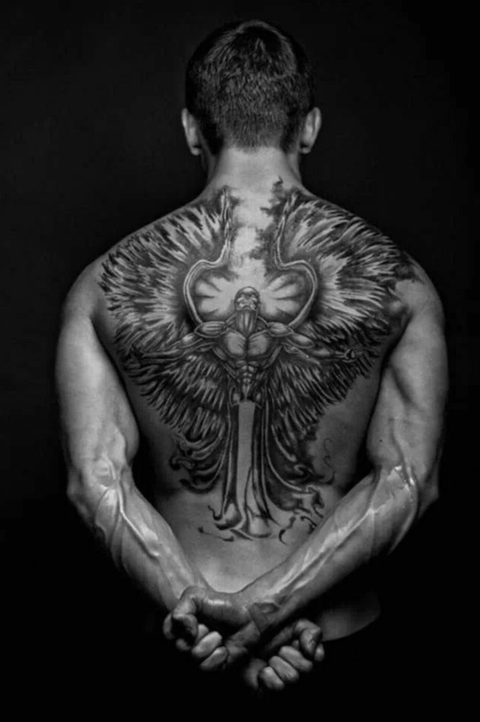 large back tattoo, black background, angel sleeve tattoo, mans body in the middle