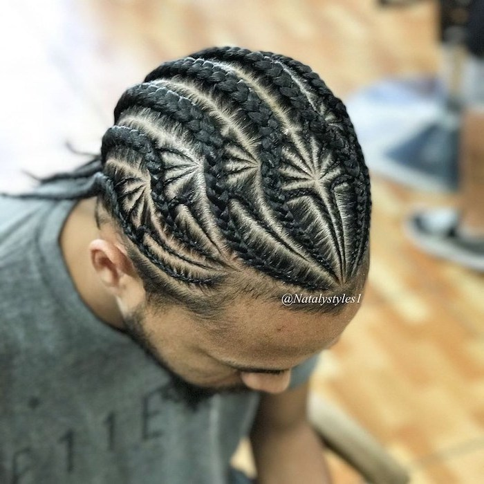 intricate design, cornrow braid hairstyles, man with black hair, wearing a gray t shirt
