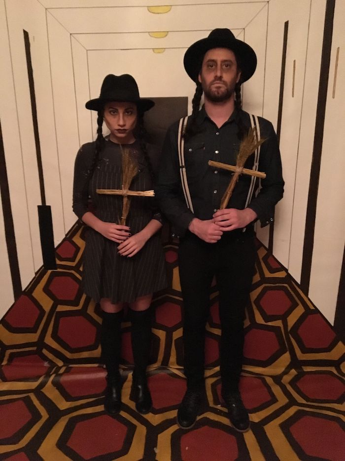 man and woman, dressed in all black, holding wooden crosses, creative halloween costumes, braided hair