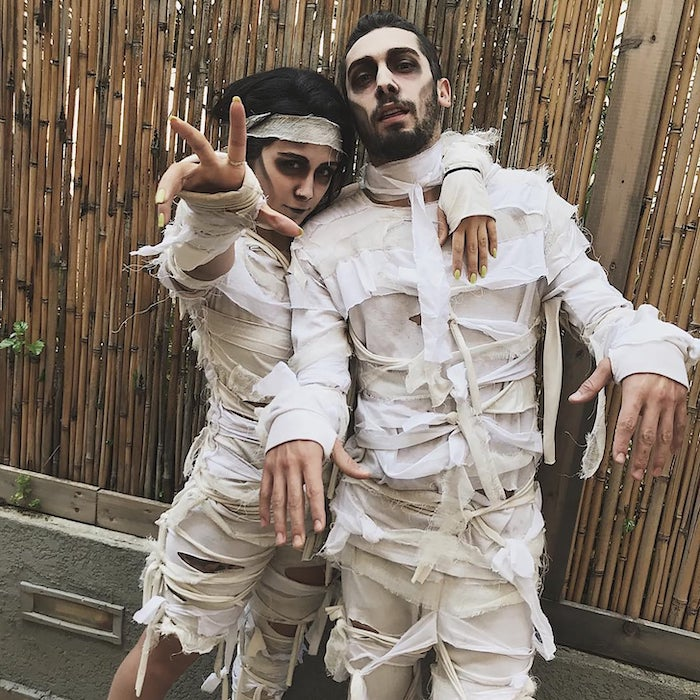 man and woman, dressed as mummies, wearing face makeup, creative halloween costumes, posing for the photo