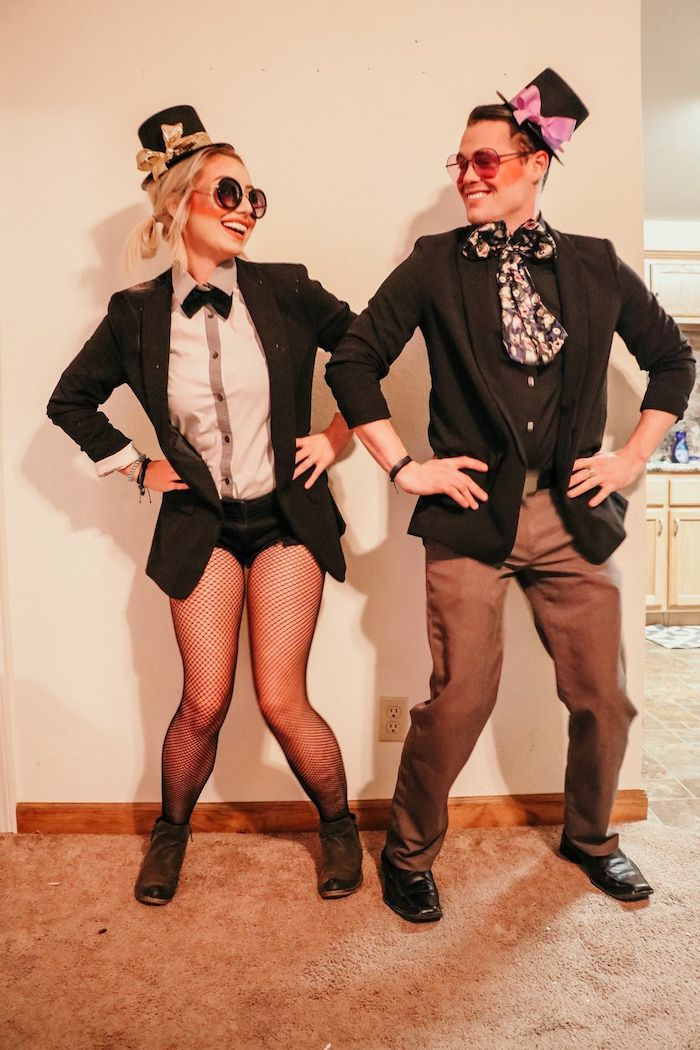 man and woman, dressed in suits, creative halloween costumes, wearing sunglasses, small hats