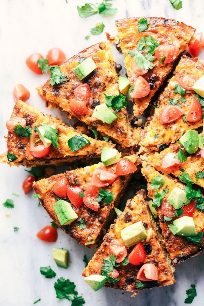 brunch potluck ideas, baked casserole, chopped avocado and tomatoes, marble countertop