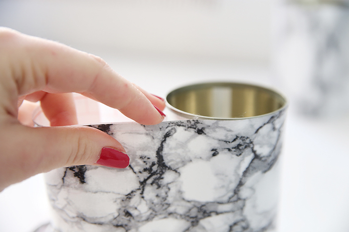 tin can, covered in marble paper, office desk decor, woman with red nail polish, step by step, diy tutorial