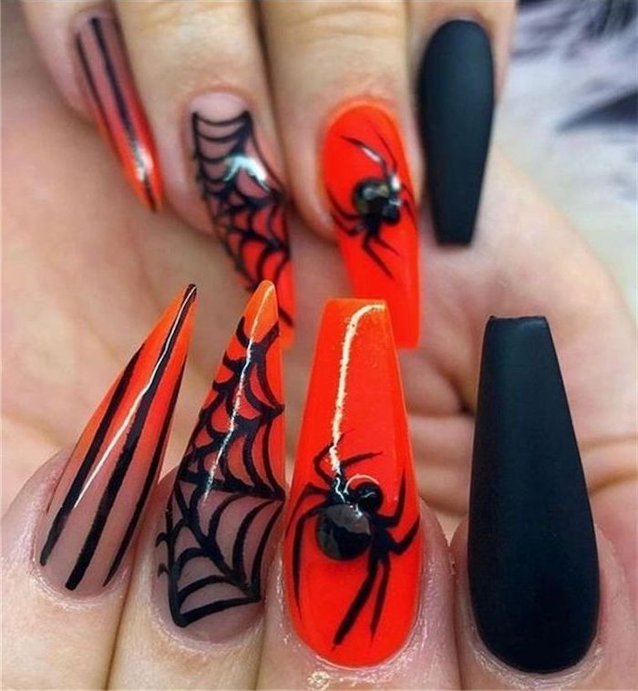 long stiletto nails, cute acrylic nail ideas, black matte nail polish, orange nail polish, spiders and webs decorations