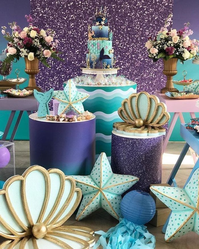 purple gold and turquoise decor, mermaid baby shower, large flower bouquets, three tier cake