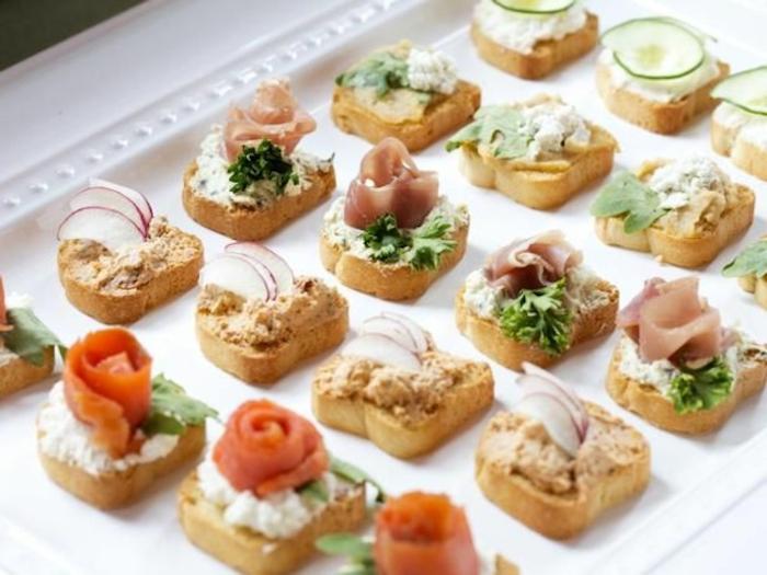 bruschetta bites, with salmon fillet, ham and cheese, brunch potluck ideas, white platter