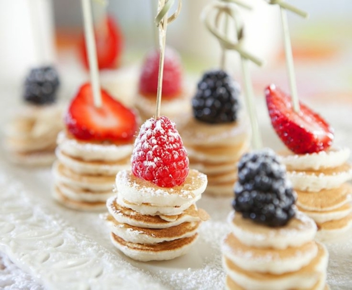 stacks of mini pancakes, raspberry and strawberry, blackberry on top, easy brunch ideas, powdered sugar