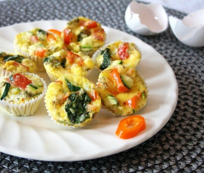 egg muffins, birthday breakfast ideas, spinach and peppers, on white plate