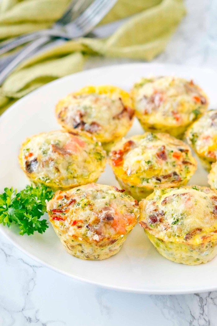 egg muffins, with peppers and tomatoes, brunch ideas, white plate, marble countertop