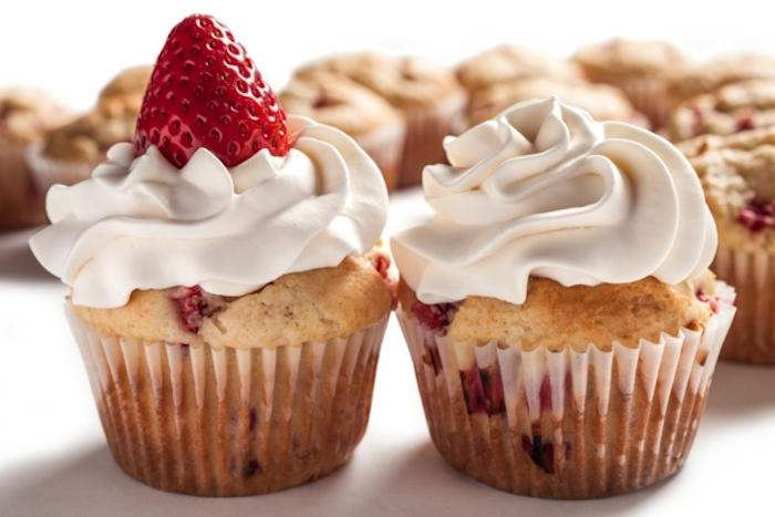 muffins with strawberries, cream on top, birthday breakfast ideas, white background