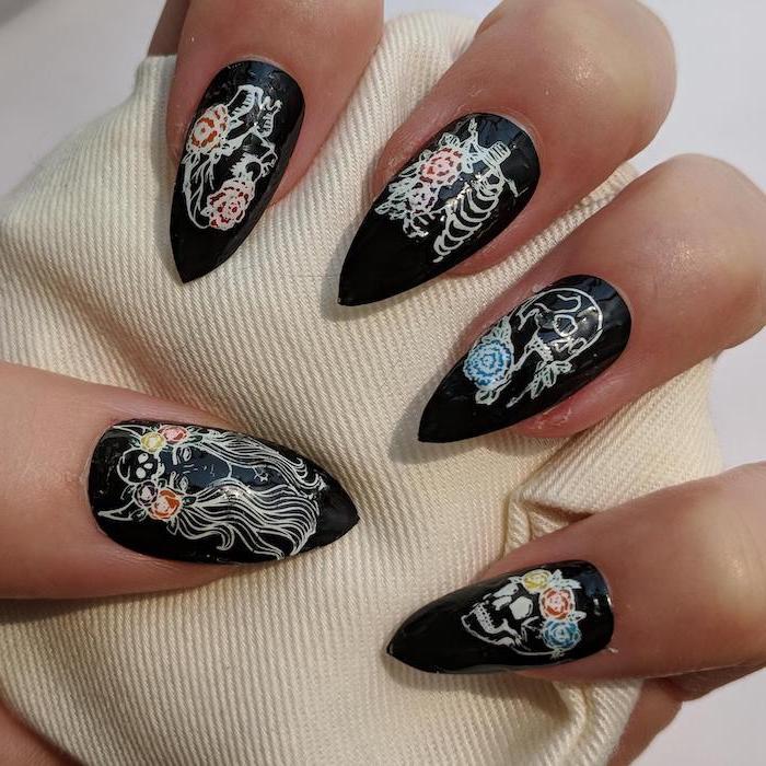 black nail polish, body parts, floral decorations, cute acrylic nail ideas, stiletto nails, white background