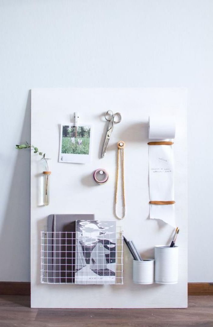 wooden board, photos and scissors pinned to it, wooden desk, white wall, office decor ideas for work
