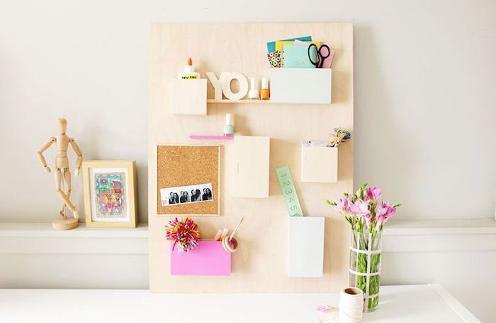 wooden board, with small shelves, office decor ideas for work, white desk, pink flower bouquet, framed art