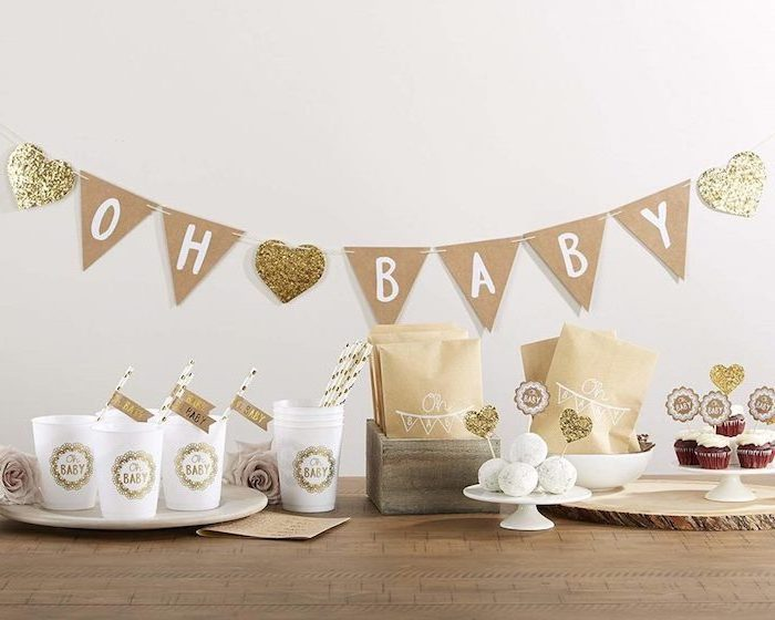 oh baby garland, on white wall, rustic decor, baby shower decoration ideas for girl, wooden table