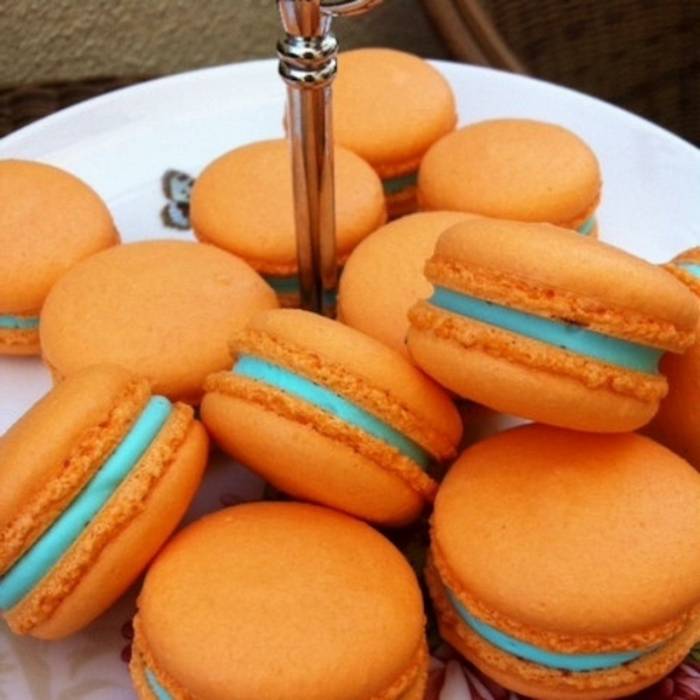 orange macarons, blue filling, breakfast and brunch, white plate