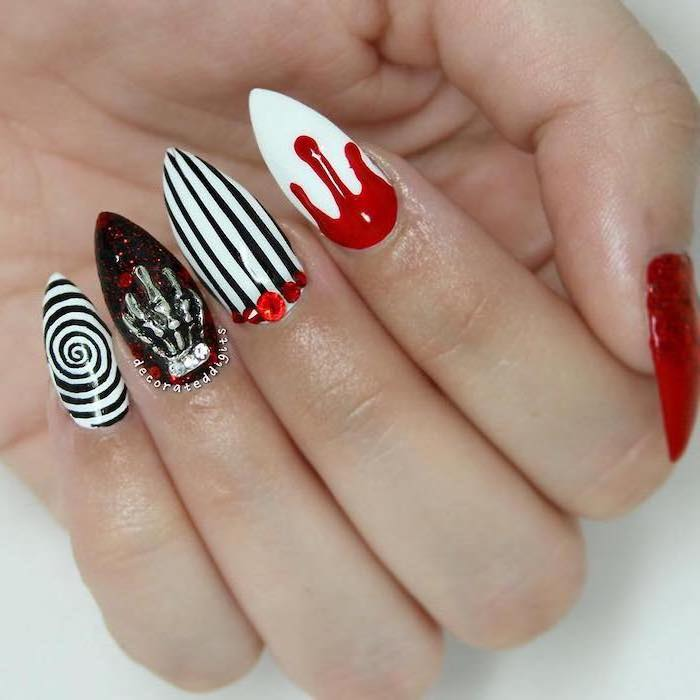 black and white, striped nail polish, stiletto nails, cute halloween nails, red nail polish, dripping down