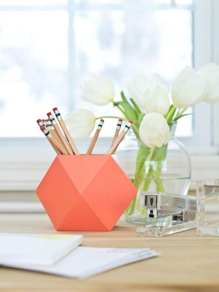 white tulips, flower bouquet, work office decor, orange pencil holder, on a wooden desk, acrylic stapler