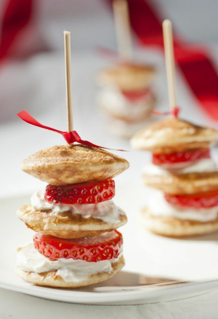 mini pancakes stack, with cream and strawberry, breakfast and brunch, red bow, white plate