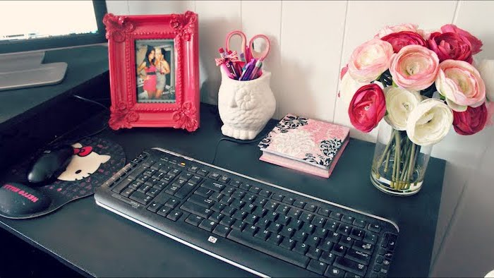 black desk, flower bouquet, work office decor, pink photo frame, hello kitty mouse pad, owl pencil holder