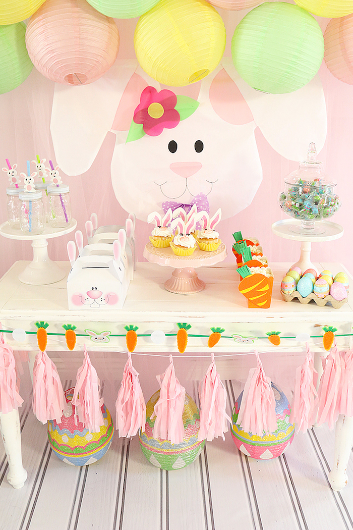pink green and yellow decorations, tassel garland, little rabbit theme, cupcakes and candy, baby shower themes