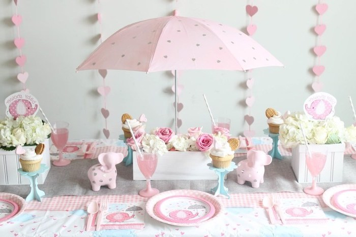 pink umbrella, pink hearts garland, flower bouquets, in wooden crates, table setting, baby shower table decorations