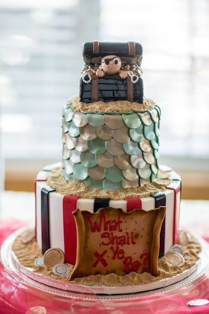 unique gender reveal party ideas, three tier cake, pirate or mermaid, pink tulle, what shall ye be