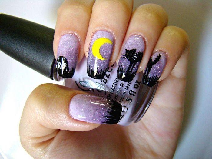 purple glitter nail polish, cute halloween nails, black cat decorations, holding purple nail polish bottle